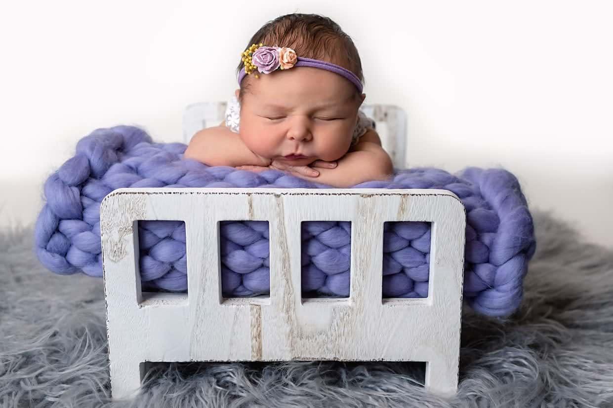 Purple Sleeping Newborn Baby In Bed In Heywood